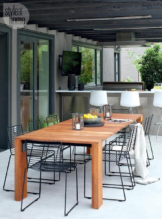 Modern patio teak table and metal chairs